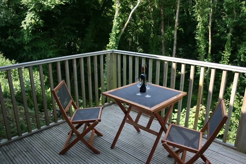 Your own private balcony overlooking the wooded valley and Nantarbeth river.