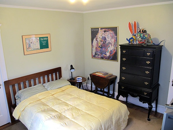 """Your room features a very comfortable bed with a size """"full"""" mattress. This room is adjacent to the shared bathroom, which is right next to the kitchen."""