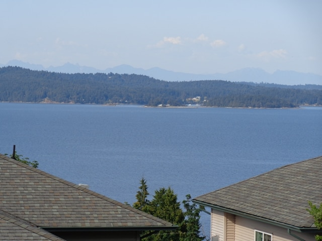 View across Stuart Channel to Thetis Island from front window (Vancouver Mountains in background)