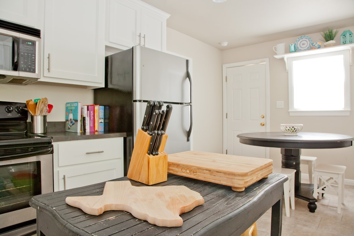 A chef's kitchen: all the utensils, new appliances, and plenty of counter space.