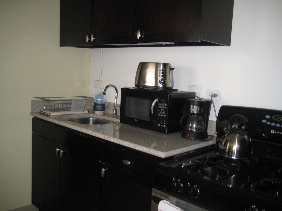 Microwave, toaster, coffee maker, gas range