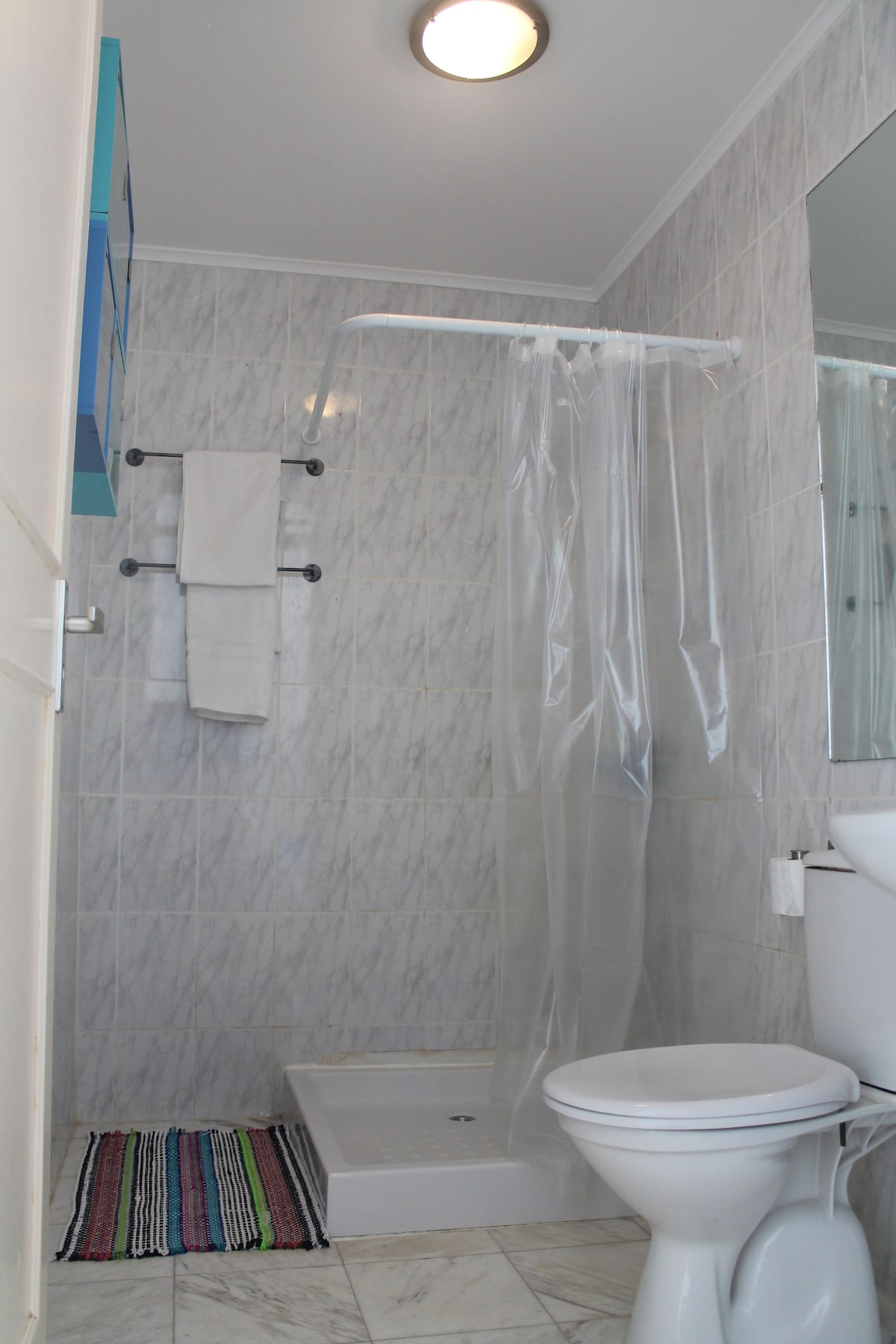 bathroom with hot water, shower