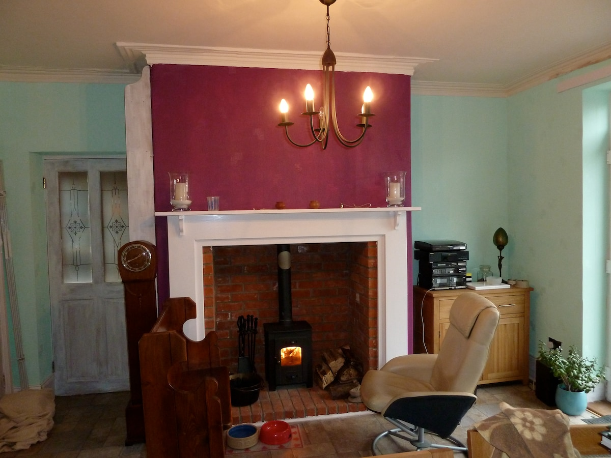 The wood burner in the dining area