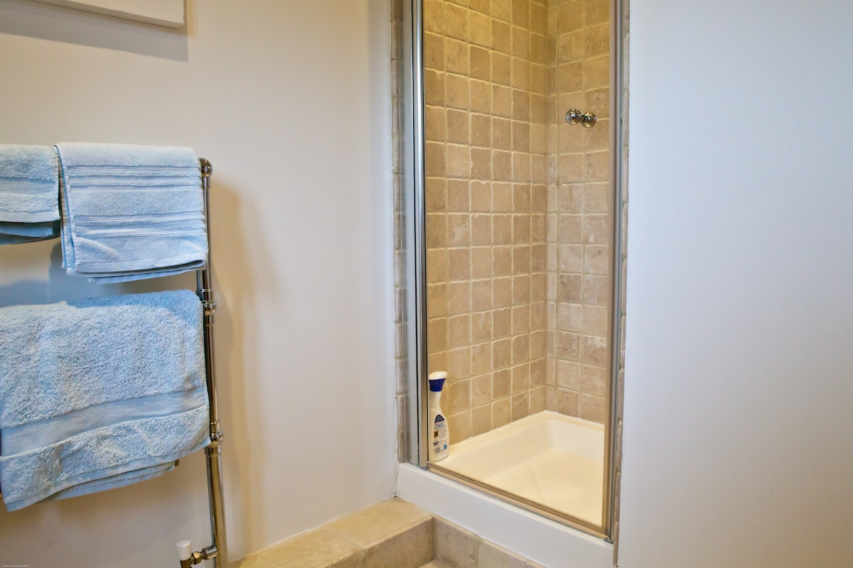 Comfortable built in shower and heated towel rail