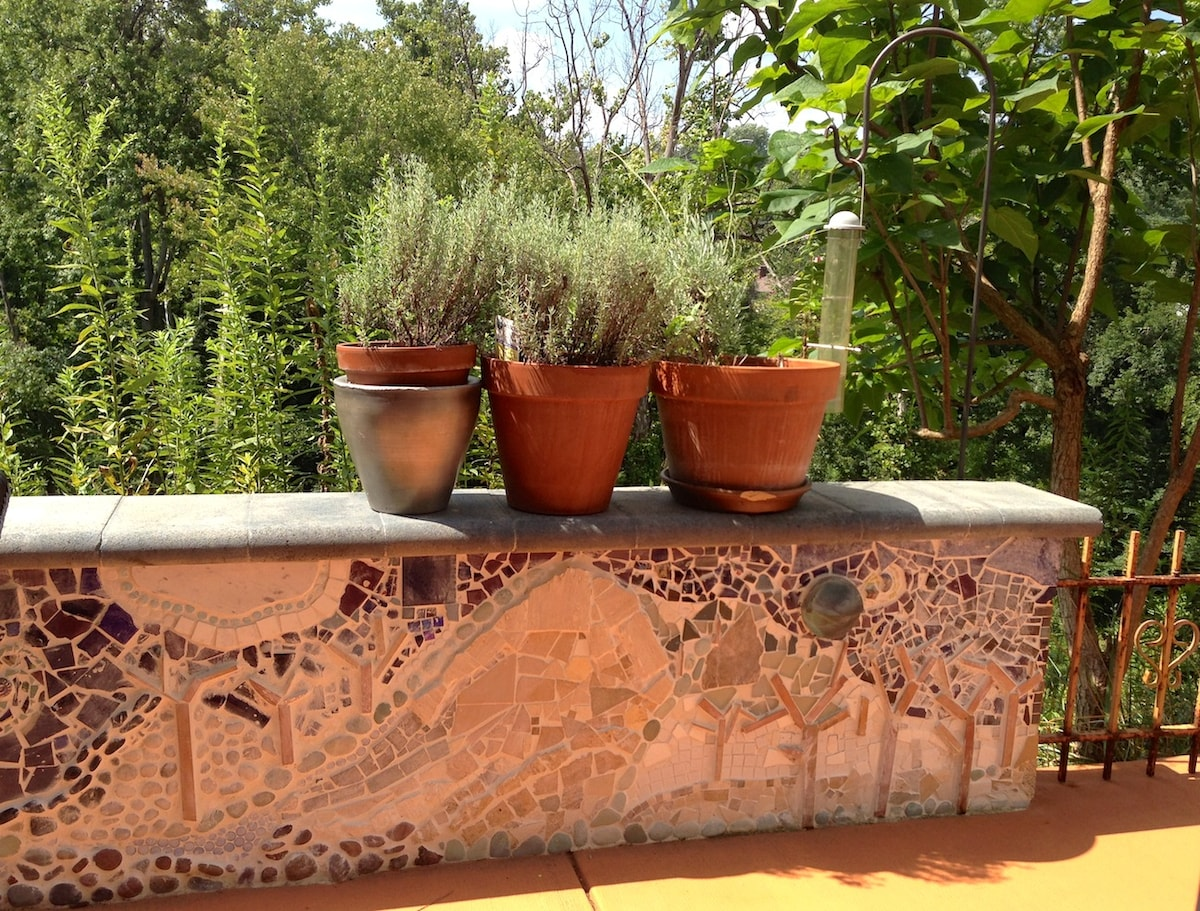 Outdoor mosaic wall surrounding your well dressed patio.