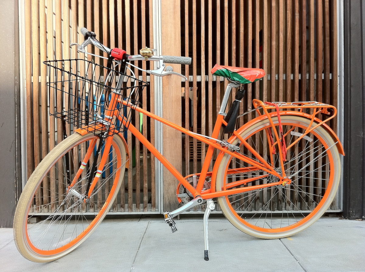 Two orange PUBLIC bicycles are available for guests to borrow.