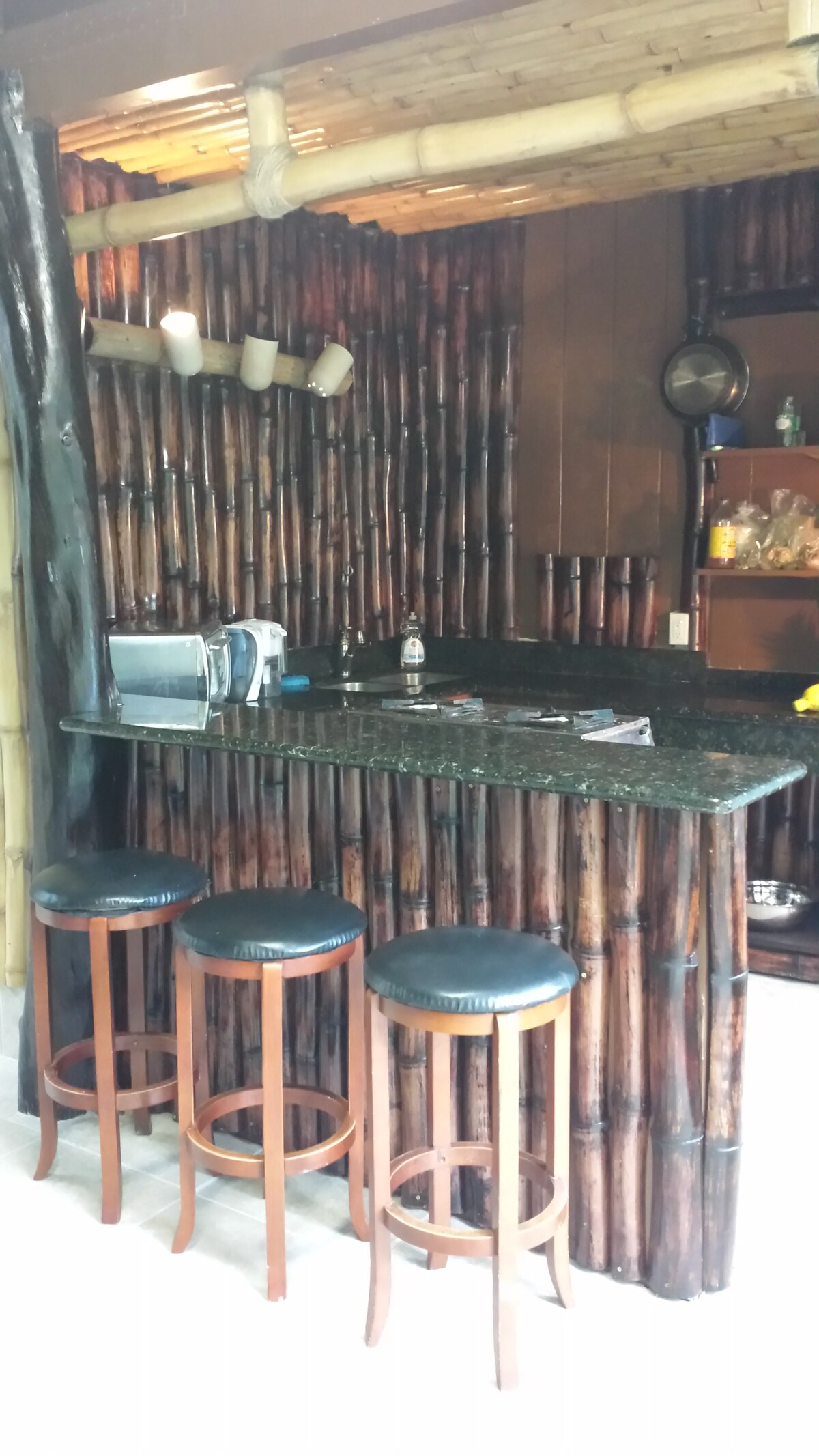 This is the kitchen and bar dining area, if you're feeling like socializing or eating in the kitchen.  All the bamboo was cut, cured, and prepared right here on the property.
