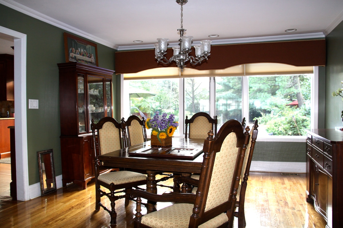 """The dining room is where we eat  almost everyday. There is nothing """"formal"""" about it. Comfortably seats 6 people and the table opens up to accommodate 10 for larger crowds."""