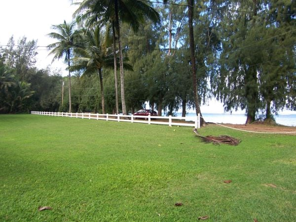The spacious lawn opens on to an even more spacious beach.