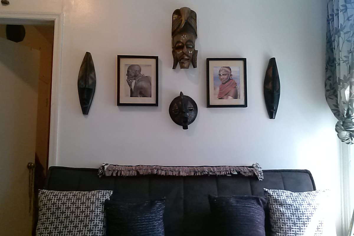 My love of African art, and my comfy couch-that converts into a double bed for 2! A total of 4 people can be accommodated.