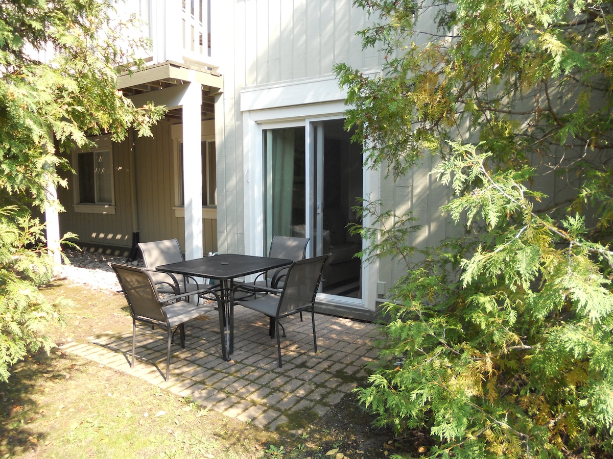 Private patio with outdoor eating area and BBQ
