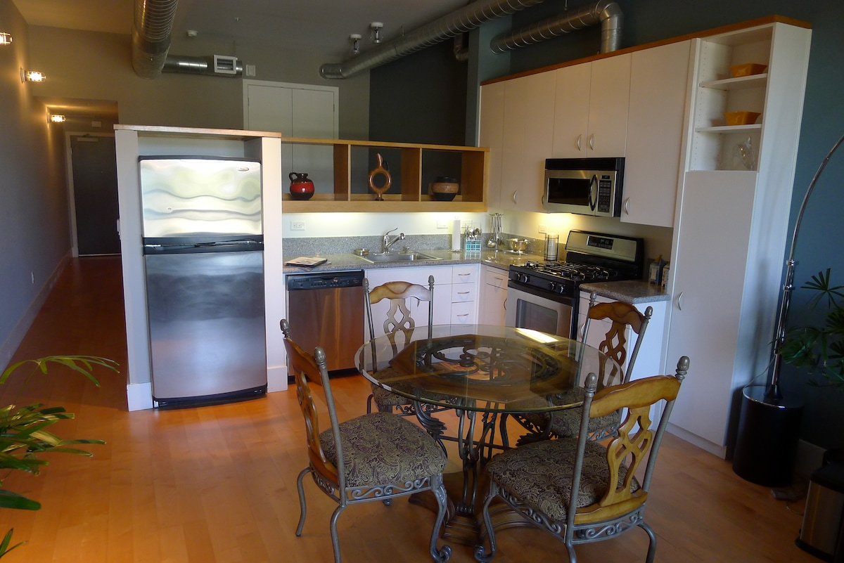 Modern appliances with microwave, dishwasher, stove, oven and refrigerator.