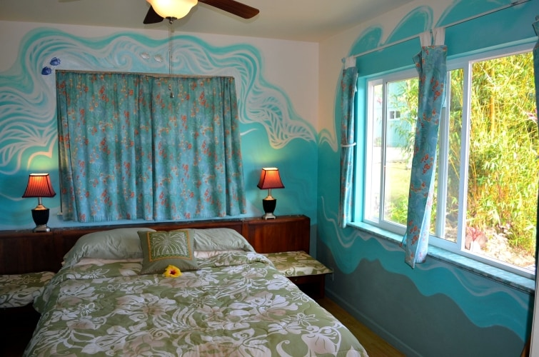 queen-sized bed in second bedroom at Whispering Bamboo Cottage