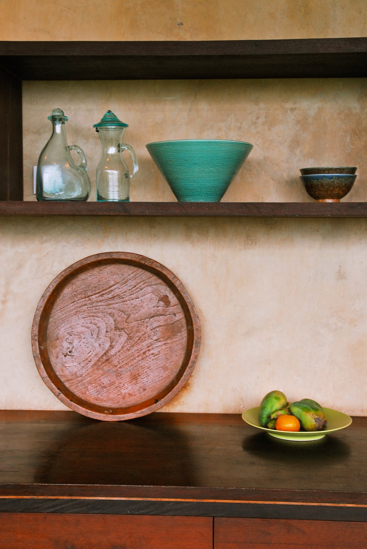 The kitchen cabinets are made from reclaimed wood