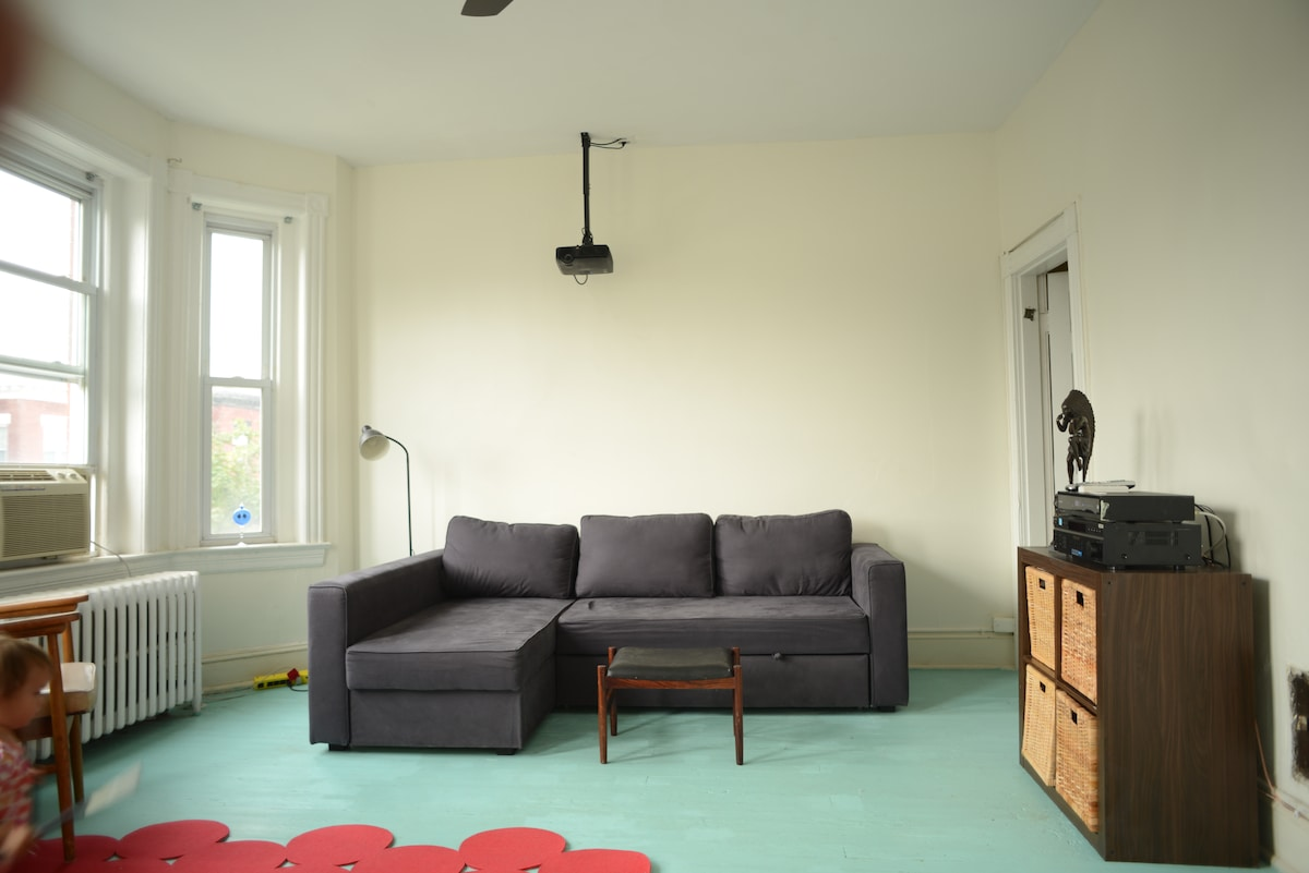 Enjoy a flick on the mounted projector or take a nap between sightseeing on this comfy couch.