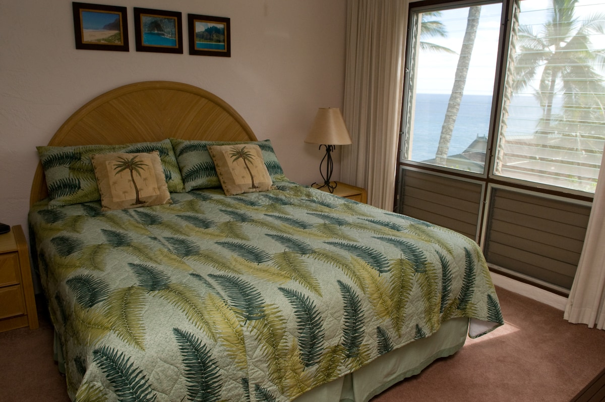 King bed with ocean view from bedroom...