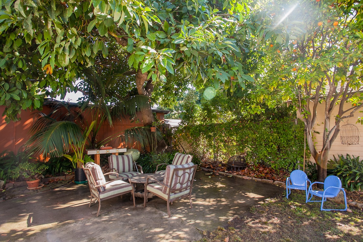Enjoy seating under shaded avocado tree.