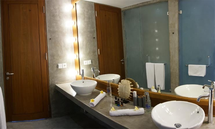 Spacious bathroom with two washbasins, separate toilet and shower