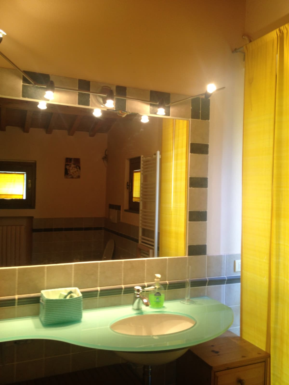 the bathroom, very charming and colorful. quite big, has got a mini pool.