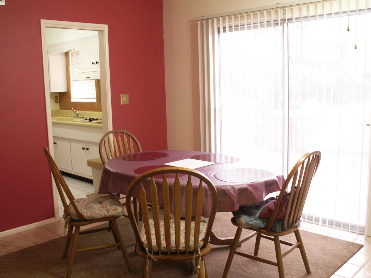 fan cooled dining area opens onto patio, kitchen thru doorway
