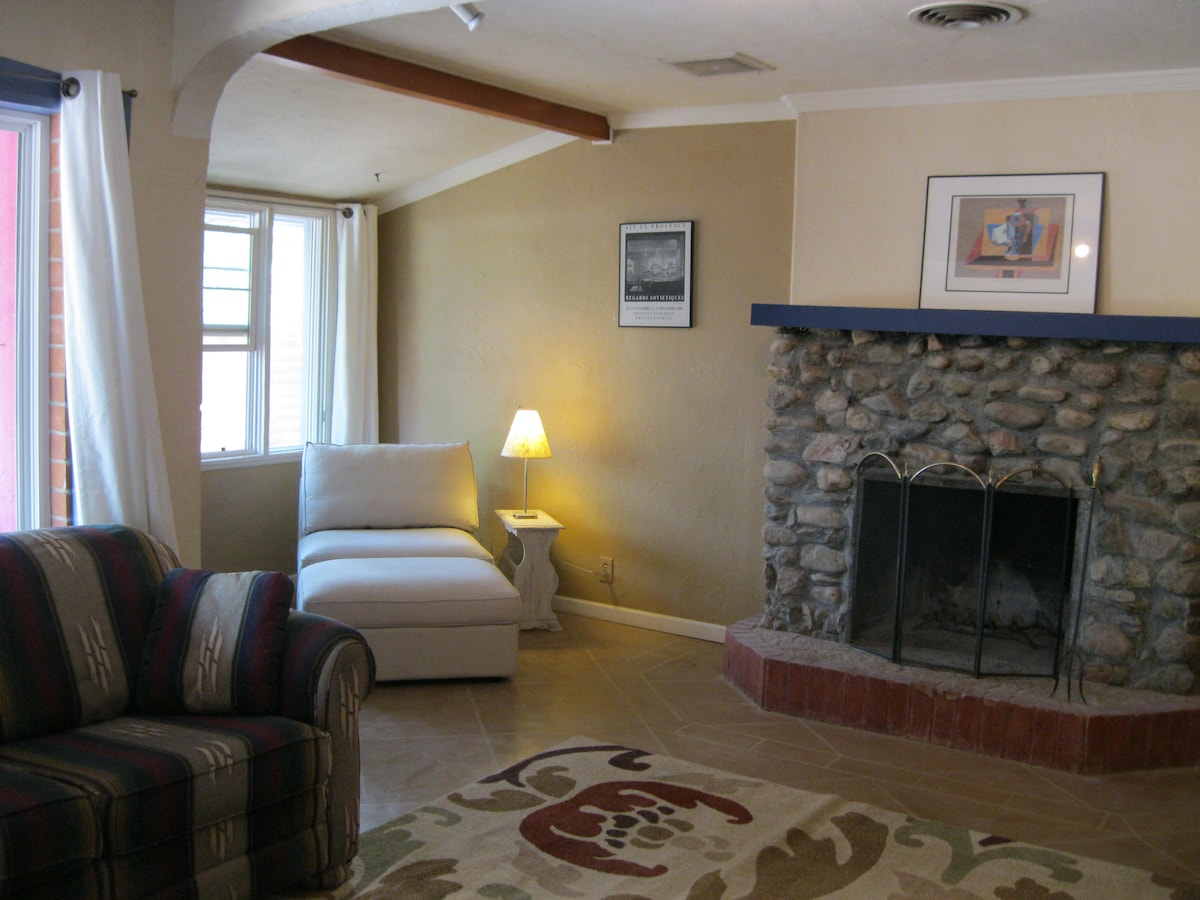 sunny living room with fireplace