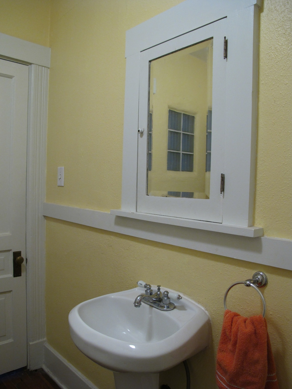The bathroom may be tiny, but it's clean and usable!