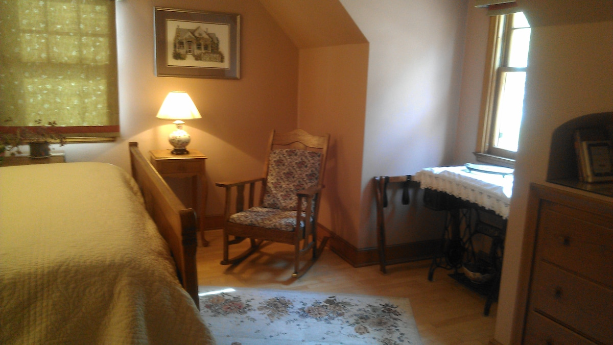 Well-lit room, 2 comfortable rocking chairs.  Luggage rack and ironing board available for use