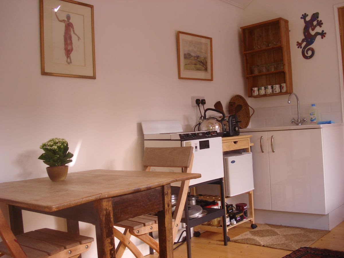 A small but well equipped kitchen. A scrubbed cottage table. Settle in - a home from home !