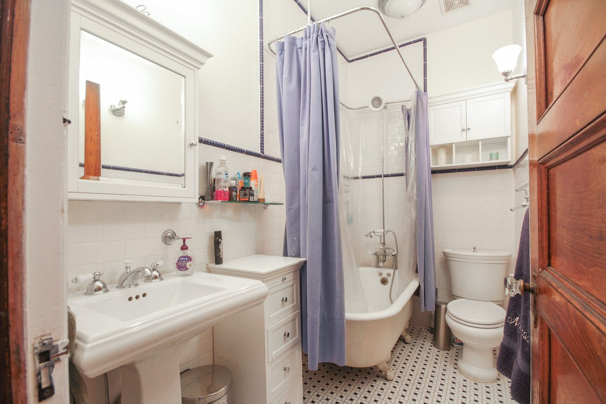 Bathroom with shower and real claw-foot tub--perfect for relaxing after a long day exploring New York City!
