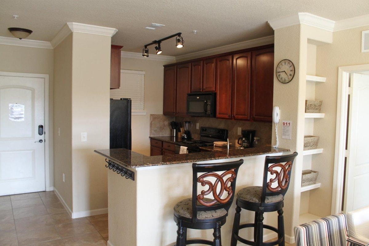 Open kitchen with bar chairs