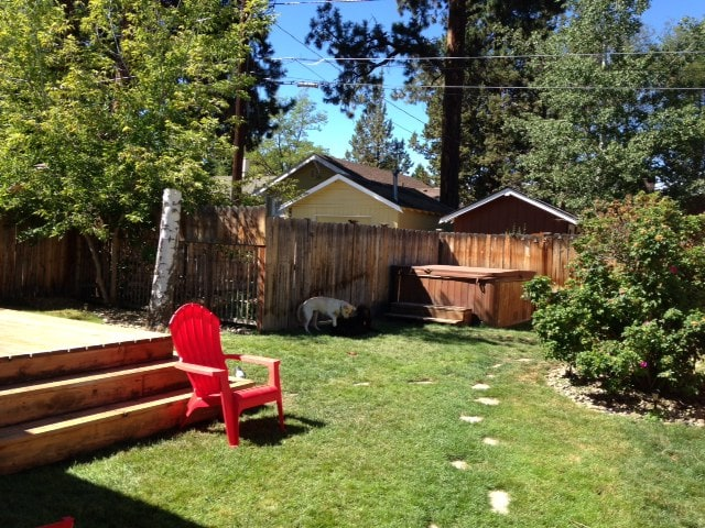 Large completely fenced backyard with hot tub, BBQ, large deck and room for dogs to play. Patio furniture for outdoor eating. Extra parking place off back alley.