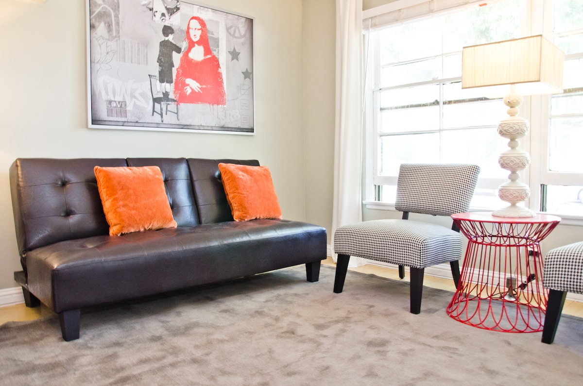 Living area with couch that makes into a queen bed