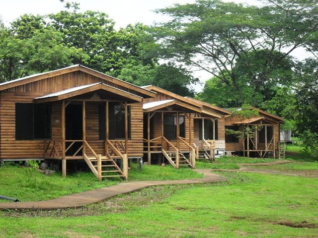 Log cabins, 2 queen beds, wood furnitures, private bath, hot water, deck, swimming pool and lagoon front.