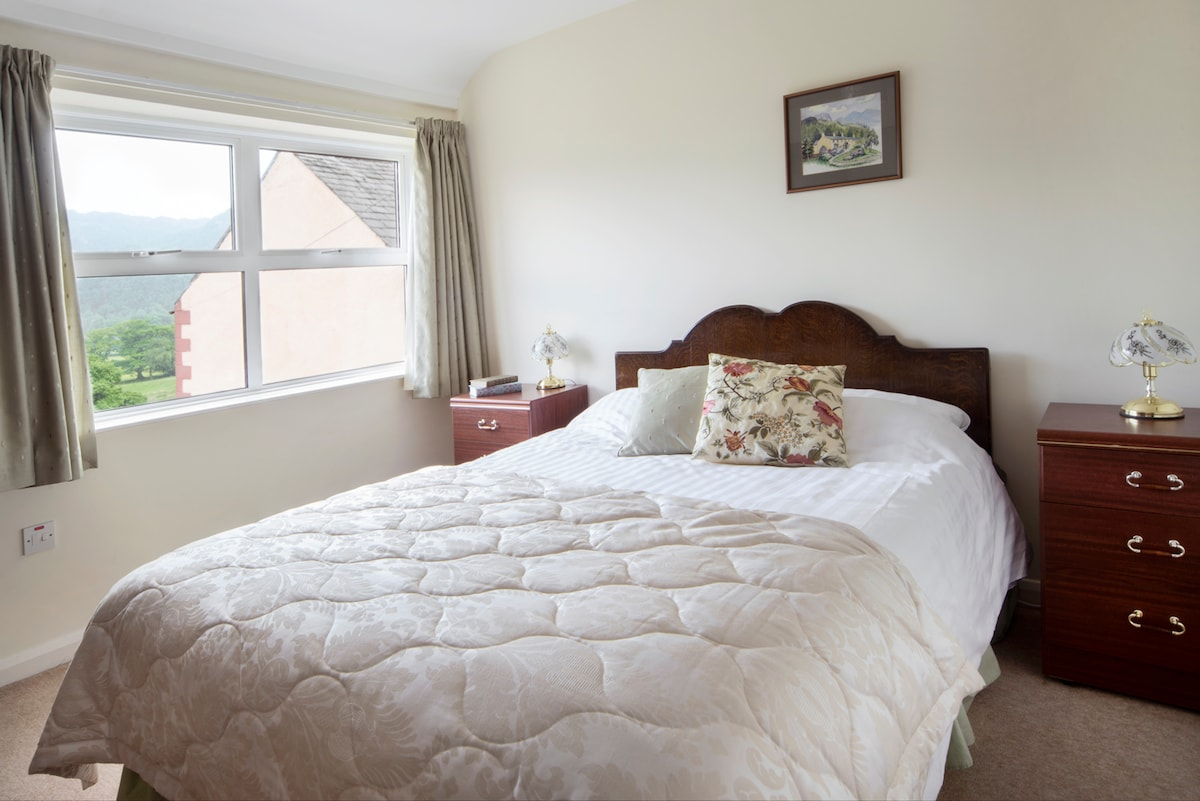 The king size double bedroom at the front shares the same great view as the kitchen.