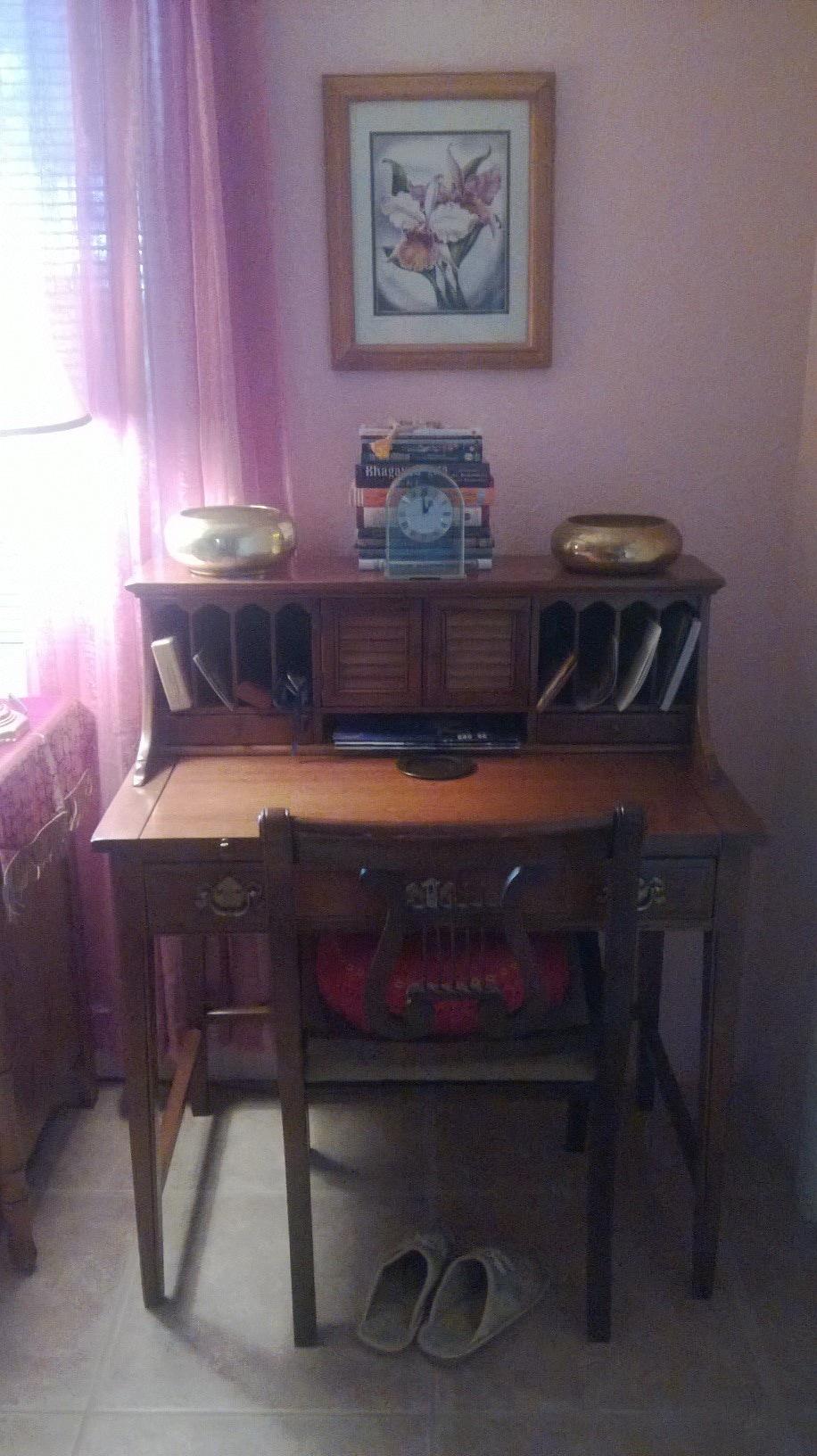 Desk in pink room.