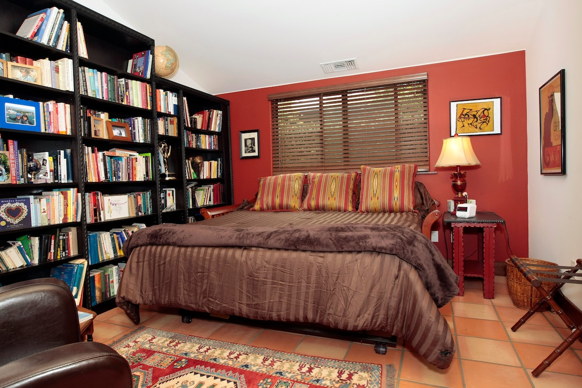 Your private room with real king bed, closets, Flat Screen, DVD player, & plenty to read.