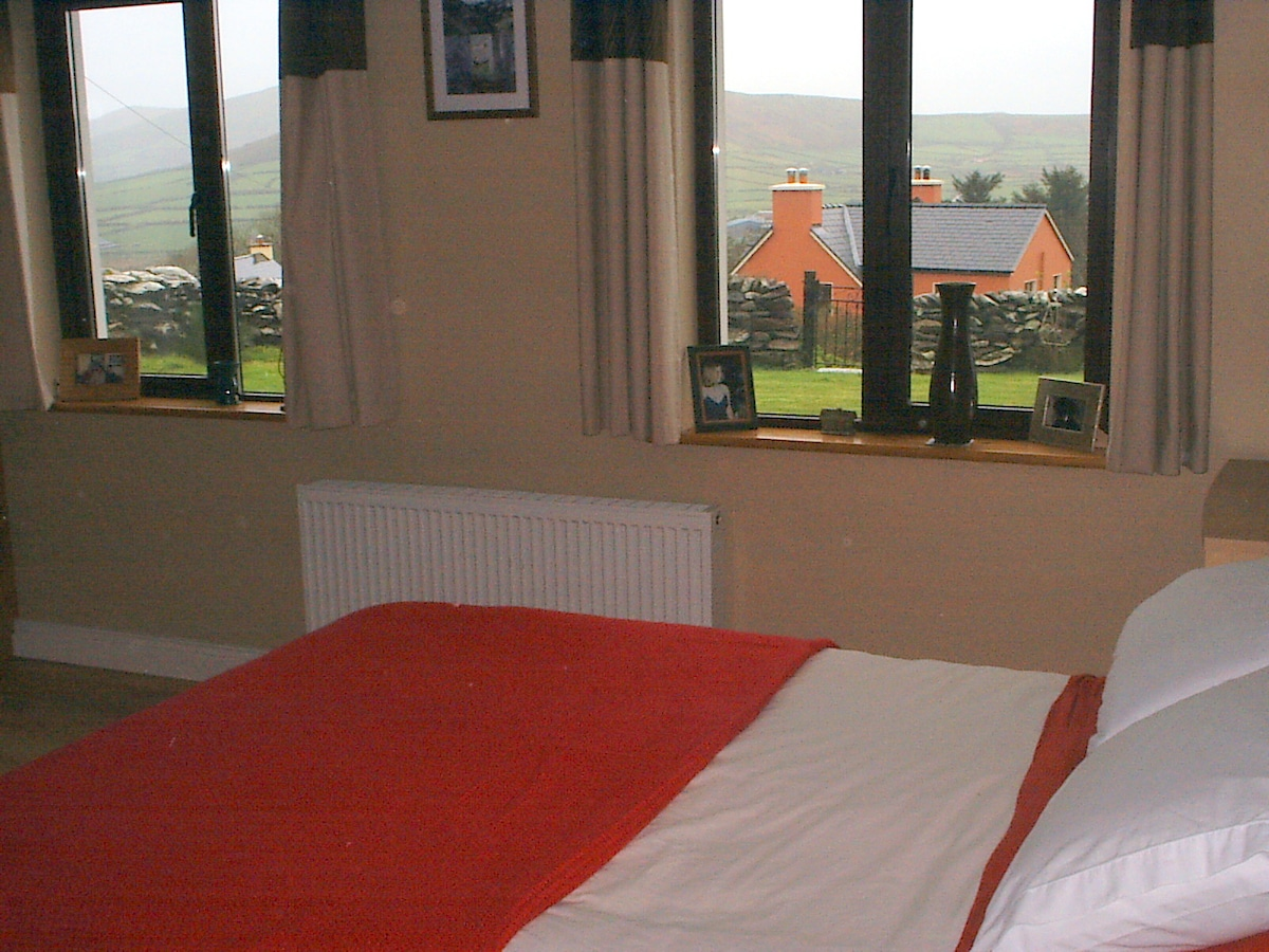 En-suite bedroom with double bed.