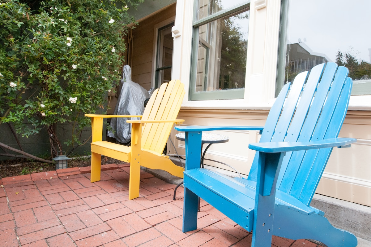 Sunny South facing patio with comfy chairs and mosaic table