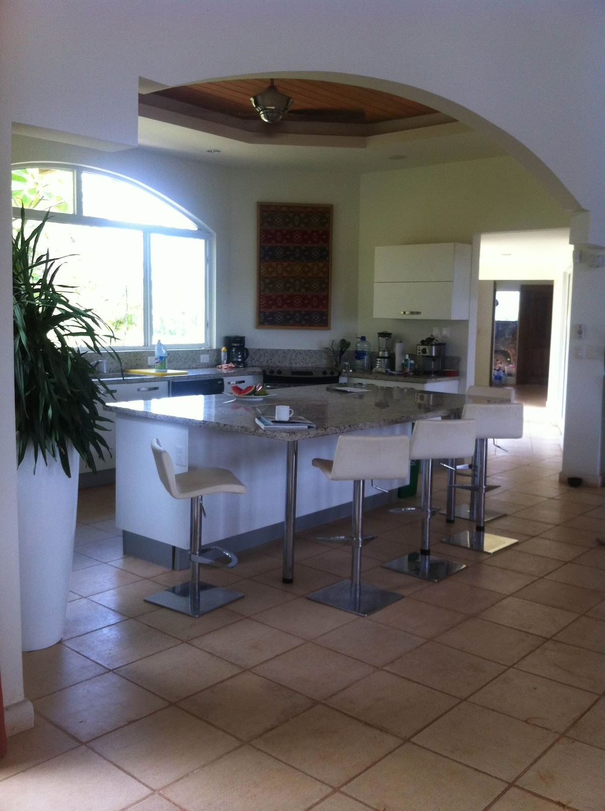 Open kitchen setup complete with espresso maker and Cuisinart appliances.
