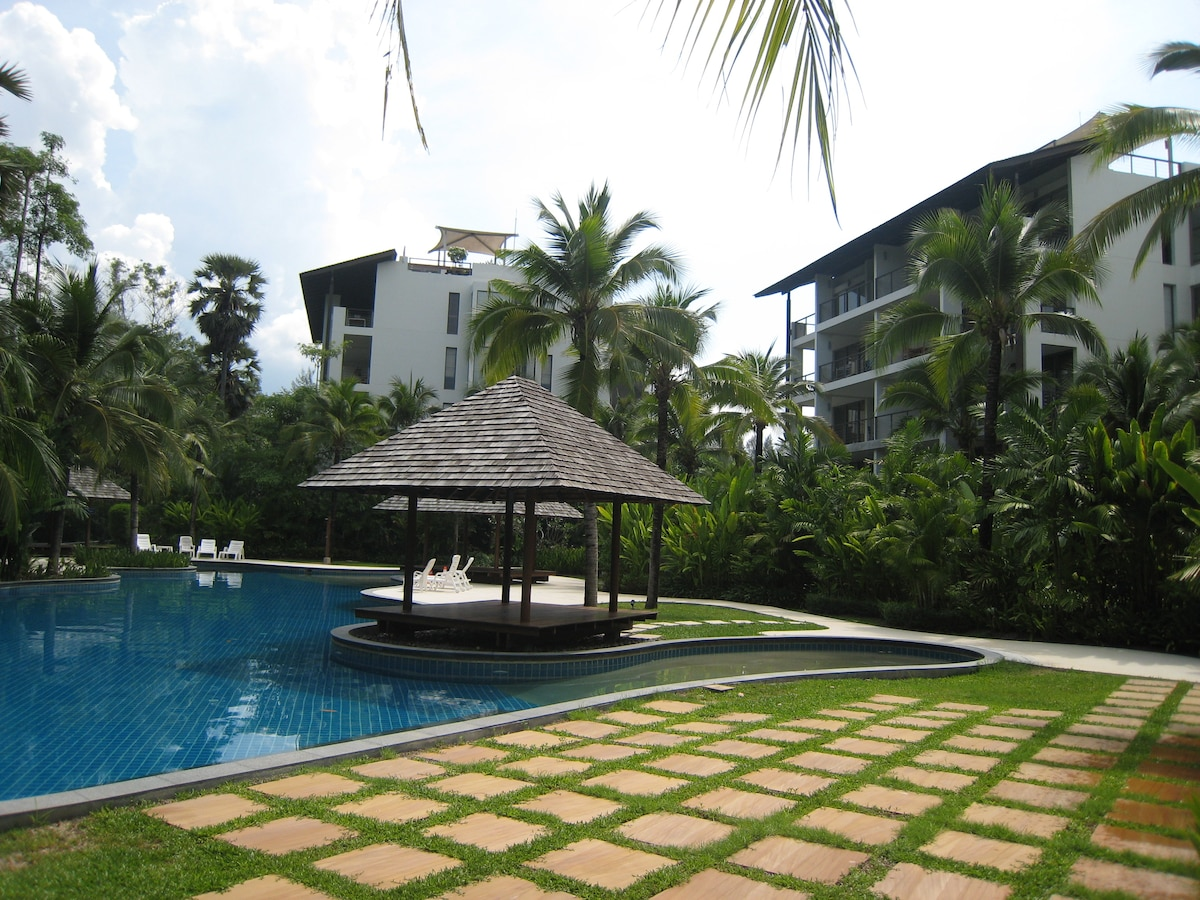 Here is another view of the free-form swimming pool and the apartment. The complex has 4 blocks of 10 units each..