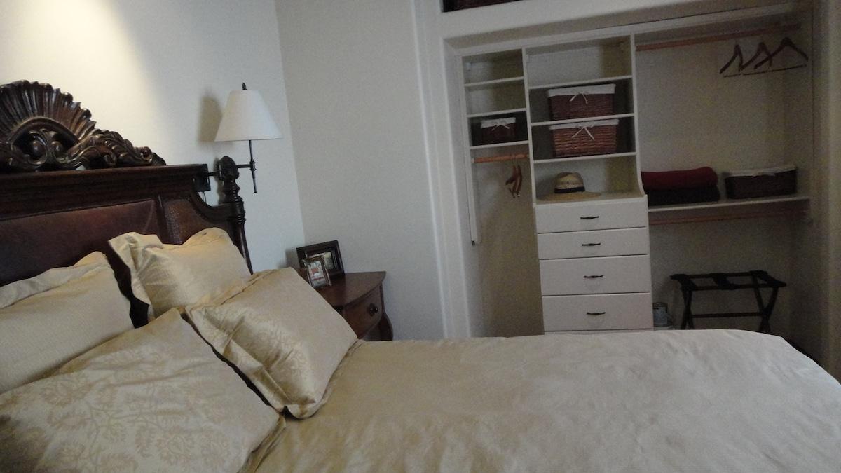 Master bedroom with custom built closet and plenty of storage.