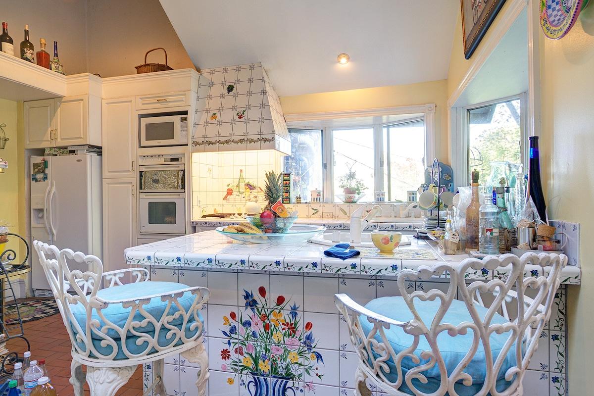 Italian tiled kitchen overlooking the bay
