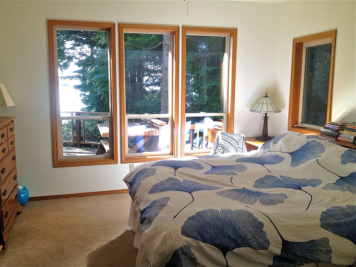 Master bedroom with morning light - wake up to the sound of waves!