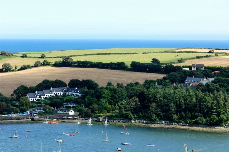 The cottages nestled into the hillside, overlooking Oysterhaven Bay.