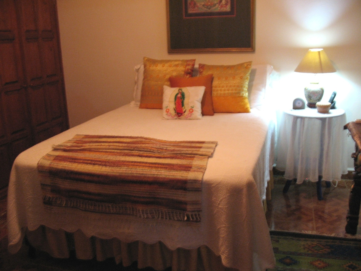 The second private room is the Recamera de Oro, the Gold Room. This room has is decorated with Gold Sari Cloth curtains and in the winter a white Matalasse bedspread with large Golden Sari Pillows and for extra comfort a Tibetan Blanket Shawl at the foot