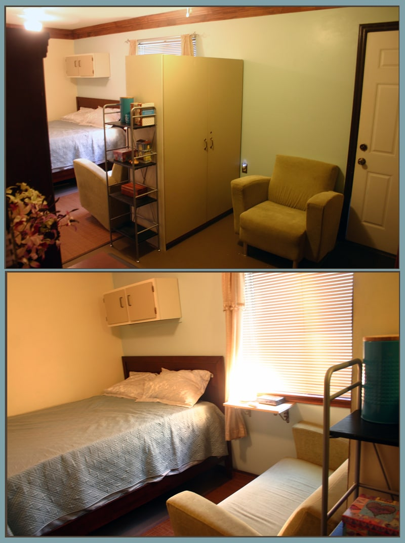 Rm.1: Large bedrm, fridge, microwave, queen bed, couch and sitting area, books, door to back.