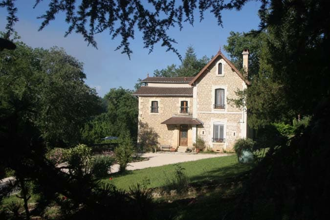 Walled and gated property on the Dordogne River.