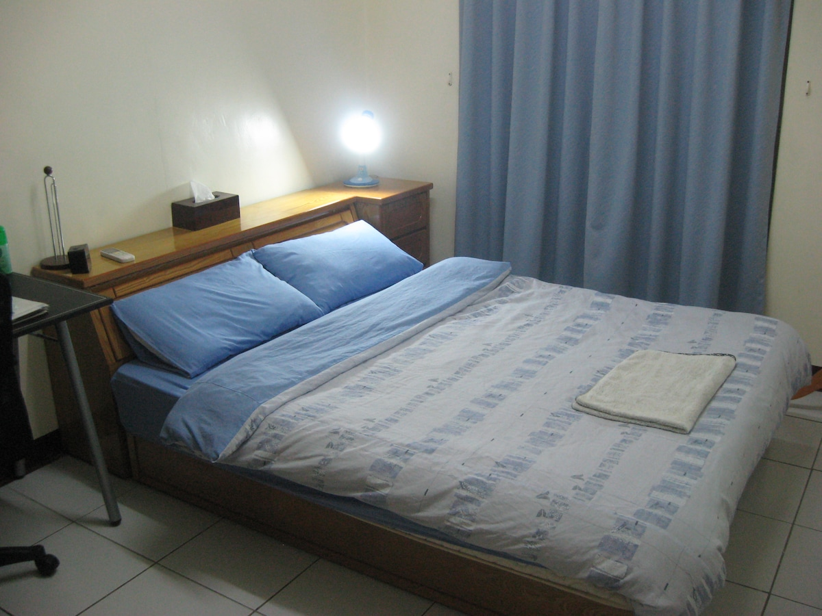 Double Air-conditioned Guestroom includes bedside lamp, king-size bed linen & extra blankets.
