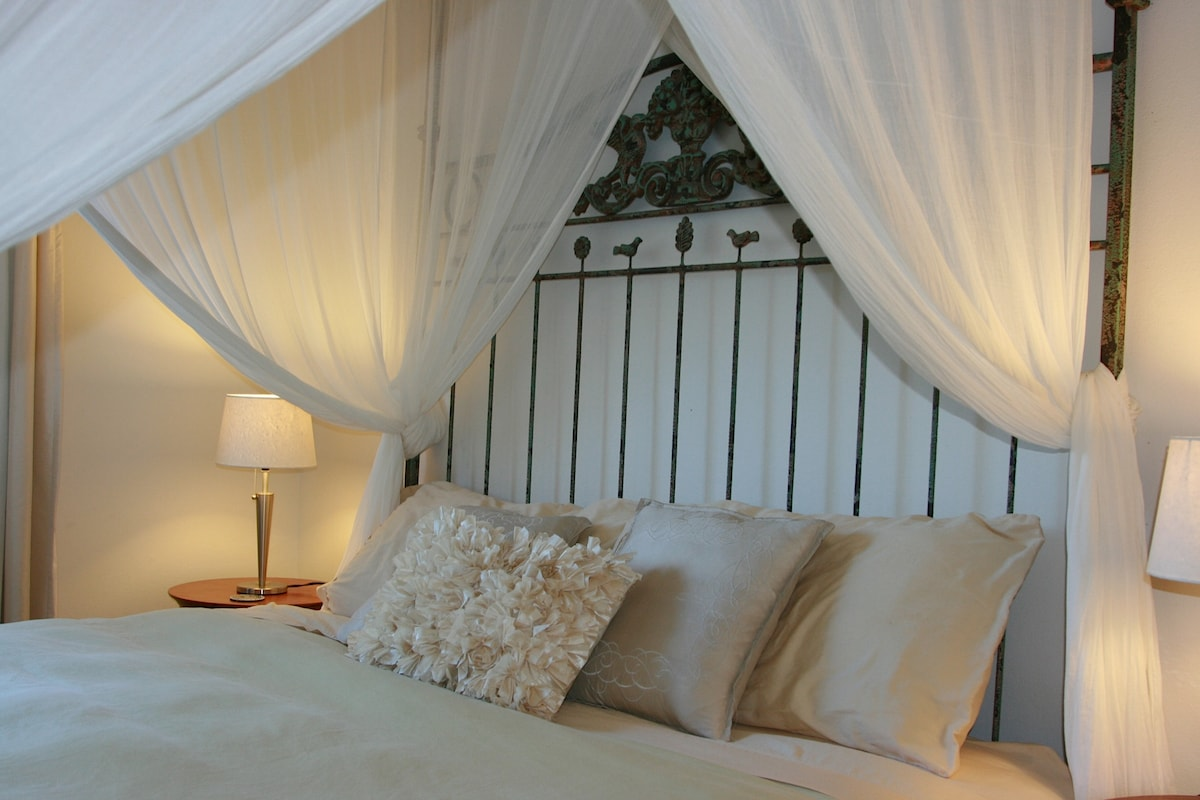 Master suite Canopy King bed, perfect for a romantic get- away weekend.