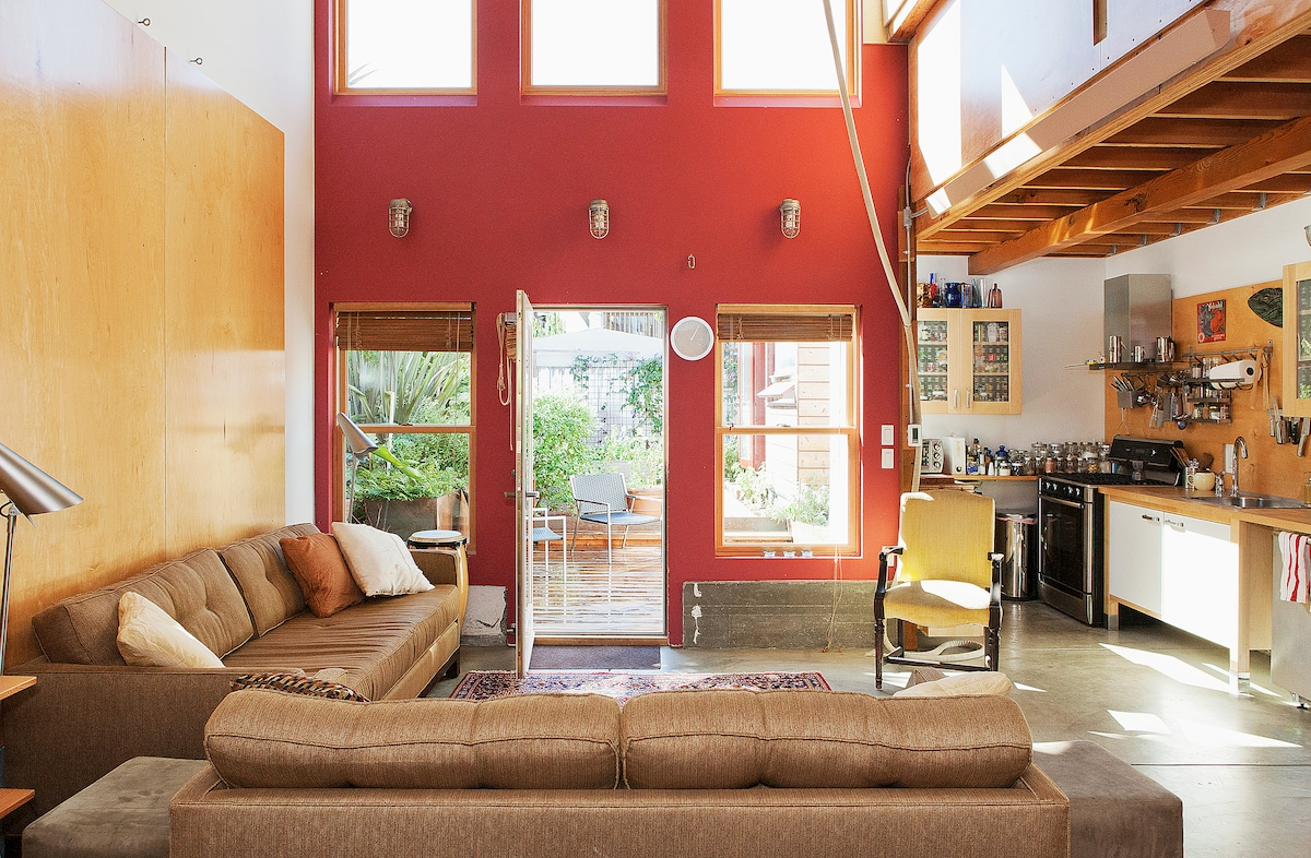 Airy, sunny living room with double-high 20 foot tall ceilings and windows onto the garden